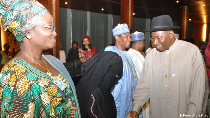 PRESIDENT GOODLUCK JONATHAN SHAKING HANDS WITH A MEMBER OF THE COMMITTEE ON DIALOGUE AND PEACEFUL RESOLUTION OF SECURITY CHALLENGES IN THE NORTH, BARR AISHA WAKILI DURING THEIR INAUGURATION AT THE PRESIDENTIAL VILLA ABUJA ON WEDNESDAY (24/4/13). LEFT IS MRS ESTHER CONDA.