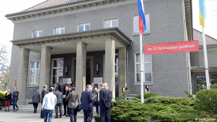 People stand outside the German-Russian Museum during its re-opening in 2013