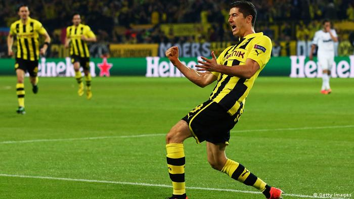 DORTMUND, GERMANY - APRIL 24: Robert Lewandowski of Borussia Dortmund celebrates scoring the opening goal during the UEFA Champions League semi final first leg match between Borussia Dortmund and Real Madrid at Signal Iduna Park on April 24, 2013 in Dortmund, Germany. (Photo by Martin Rose/Bongarts/Getty Images)