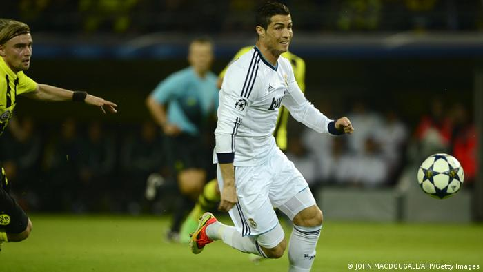 Real Madrid's Portuguese forward Cristiano Ronaldo (R) runs with the ball during the UEFA Champions League semi final first leg football match between Borussia Dortmund and Real Madrid on April 24, 2013 in Dortmund, western Germany. AFP PHOTO / JOHN MACDOUGALL (Photo credit should read JOHN MACDOUGALL/AFP/Getty Images)