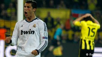 Real Madrid's Cristiano Ronaldo (L) celebrates after scoring a goal against Borussia Dortmund during their Champions League semi-final first leg soccer match at BVB stadium in Dortmund April 24, 2013. (Photo: REUTERS/Ina Fassbender)