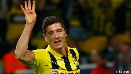 Robert Lewandowski gestures as he celebrates after scoring a fourth goal against Real Madrid during their Champions League semi-final first leg soccer match at BVB stadium in Dortmund April 24, 2013. REUTERS/Kai Pfaffenbach