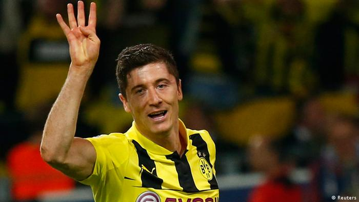 Borussia Dortmund's Robert Lewandowski gestures as he celebrates after scoring a fourth goal against Real Madrid during their Champions League semi-final first leg soccer match at BVB stadium in Dortmund April 24, 2013. REUTERS/Kai Pfaffenbach (GERMANY - Tags: SPORT SOCCER)
