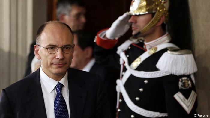 Deputy leader of Italy's center-left Democratic Party (PD) Enrico Letta arrives to speak to reporters at the Quirinale Palace in Rome April 24, 2013. Photo: REUTERS/Max Rossi