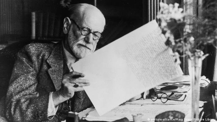 SIGMUND FREUD (1856 - 1939) Austrian neurologist and founder of psychoanalysis reading a manuscript. (Photo: Mary Evans Picture Library)