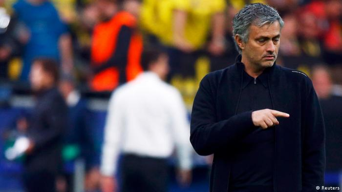 Real Madrid's coach Jose Mourinho (L) reacts beside Borussia Dortmund's coach Juergen Klopp during their Champions League semi-final first leg soccer match in Dortmund April 24, 2013. REUTERS/Wolfgang Rattay (GERMANY - Tags: SPORT SOCCER)