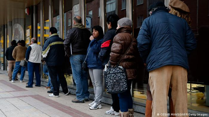 People queue outside a government employment office in Burgos CESAR MANSO/AFP/Getty Images