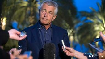 U.S. Secretary of Defense Chuck Hagel speaks with reporters after reading a statement on chemical weapon use in Syria during a news conference in Abu Dhabi April 25, 2013. Hagel on Thursday said the U.S. intelligence community believes the Syrian government has used sarin gas on a small scale against rebels trying to overthrow the government of Bashar al-Assad. REUTERS/Jim Watson/Pool (UNITED ARAB EMIRATES - Tags: POLITICS)