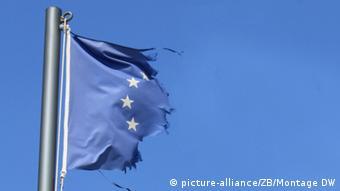 A torn blue EU flag flaps against a blue sky. Photo: Frank Schumann