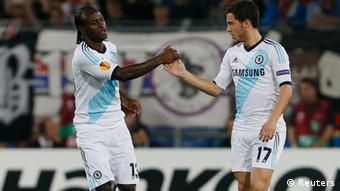 Chelsea's Victor Moses celebrates with his team mate Eden Hazard (R) after scoring a goal against FC Basel during their Europa League semi-final first leg soccer match at St. Jakob Park stadium in Basel April 25, 2013. (Photo: REUTERS/Pascal Lauener)