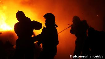 Fire fighters try to put out a Moscow fire