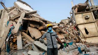A rescue worker stands in front of the rubble of the collapsed Rana Plaza building, in Savar, 30 km (19 miles) outside Dhaka April 26, 2013. (Photo: Reuters)