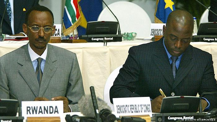DRC President Joseph Kabila and Paul Kagame are at a 30 July 2002 meeting in Pretoria. Photo: dpa