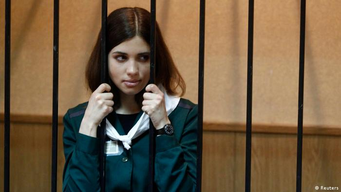 Pussy Riot band member Nadezhda Tolokonnikova looks out from a holding cell during a court hearing earlier this year. (Photo: Mikhail Voskresensky/Reuters)