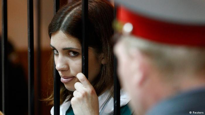 Pussy Riot band member Nadia Tolokonnikova looks out from a holding cell during a court hearing in the town of Zubova Polyana April 26, 2013. Tolokonnikova is appealing her conviction for hooliganism motivated by religious hate for which she is serving two years in a remote penal colony. REUTERS/Mikhail Voskresensky (RUSSIA - Tags: POLITICS CIVIL UNREST CRIME LAW RELIGION TPX IMAGES OF THE DAY)