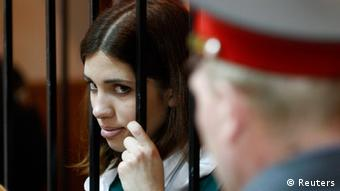 Nadia Tolokonnikova looks out from a holding cell REUTERS/Mikhail Voskresensky