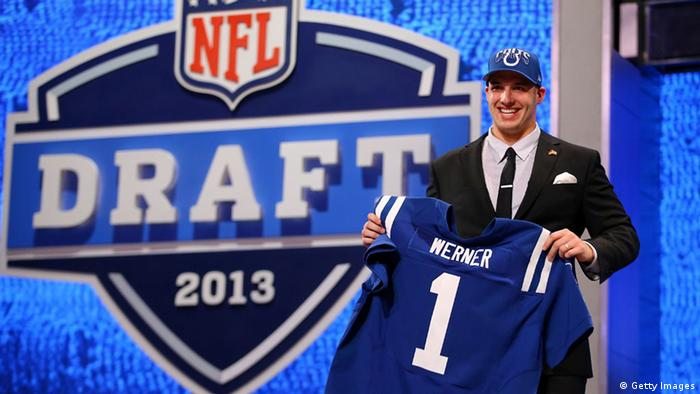 NEW YORK, NY - APRIL 25: Bjoern Werner of the Florida State Seminoles holds up a jersey on stage after he was picked #24 overall by the Indianapolis Colts in the first round of the 2013 NFL Draft at Radio City Music Hall on April 25, 2013 in New York City. (Photo by Al Bello/Getty Images)