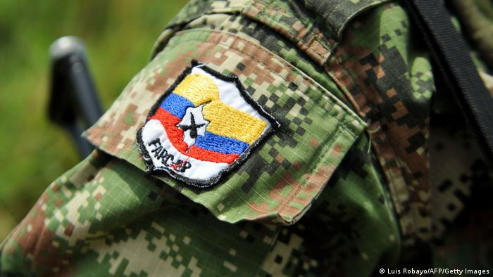Picture of a badge on the arm of member of the Revolutionary Armed Forces of Colombia (FARC) guerrillas, taken while he guards the mountainous region of the department of Cauca, around Montealagre, Colombia, on February 15, 2013 after they released Colombian police officers Victor Alfonso Gonzalez and Cristian Camilo Yate. Leftist Colombian guerrillas on Friday released two police officers they had held for three weeks, the International Committee of the Red Cross said. The men were released in a rural area in Cauca department in southwestern Colombia and were in good health, the ICRC said in a statement. (Photo: LUIS ROBAYO/AFP/Getty Images)