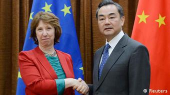 European Union Foreign Policy Chief Catherine Ashton (L) shakes hands with Chinese Foreign Minister Wang Yi before their meeting at the Chinese Foreign Ministry in Beijing April 27, 2013. REUTERS/Yohsuke Mizuno/Pool (CHINA - Tags: POLITICS)