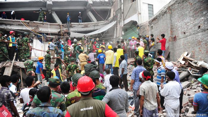 Bangladeshi soldiers assist volunteers and rescue workers looking for survivors three days after an eight-story building collapsed in Savar, on the outskirts of Dhaka on April 27, 2013. MUNIR UZ ZAMAN/ AFP/Getty Images