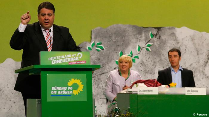 Leaders of Germany's environmental party Die Gruenen (The Greens) Cem Oezdemir (R) and Claudia Roth (C) follow a guest speech by chairman of the German Social Democratic Party (SPD) Sigmar Gabriel (Photo via Reuters)