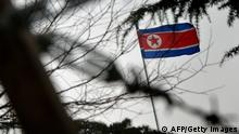 The North Korean flag flies outside their embassy in Beijing on December 12, 2012. North Korea successfully launched a long-range rocket on December 12, in defiance of UN sanctions threats over what Pyongyang's critics have condemned as a disguised ballistic missile test. North Korea said the three-stage rocket, which Pyongyang insists was solely aimed at placing a satellite in orbit, had achieved all its objectives. AFP PHOTO/Mark RALSTON (Photo credit should read MARK RALSTON/AFP/Getty Images)