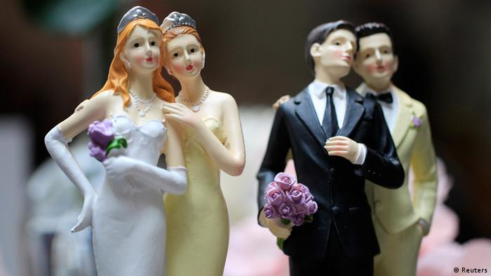 Same-sex couple plastic figurines are displayed during a gay wedding fair (salon du mariage gay) in Paris April 27, 2013, four days after the French parliament approved a law allowing same-sex couples to marry and adopt children. (Photo: REUTERS/Gonzalo Fuentes)