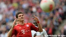 Bayern Munich's striker Mario Gomez reacts during the German first division Bundesliga football match FC Bayern Munich vs SC Freiburg in Munich, southern Germany on April 27, 2013. AFP PHOTO / CHRISTOF STACHE RESTRICTIONS / EMBARGO - DFL RULES TO LIMIT THE ONLINE USAGE DURING MATCH TIME TO 15 PICTURES PER MATCH. IMAGE SEQUENCES TO SIMULATE VIDEO IS NOT ALLOWED AT ANY TIME. FOR FURTHER QUERIES PLEASE CONTACT THE DFL DIRECTLY AT + 49 69 650050 (Photo credit should read CHRISTOF STACHE/AFP/Getty Images)