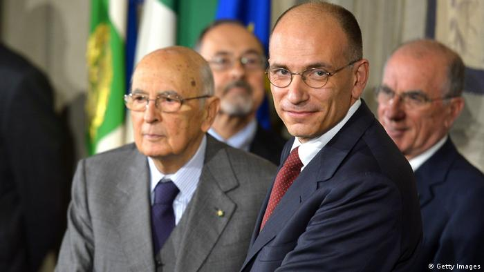 Italian prime minister-designate leftist Enrico Letta (R) shakes hand with President Giorgio Napolitano after he announced his new government following their meeting at the Quirinale presidential palace on April 27, 2013 in Rome. AFP PHOTO / VINCENZO PINTO (Photo credit should read VINCENZO PINTO/AFP/Getty Images)