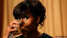 U.S. first lady Obama drinks a toast during the White House Correspondents Association Dinner in Washington U.S. first lady Michelle Obama drinks a toast during the White House Correspondents Association Dinner in Washington April 27, 2013. REUTERS/Kevin Lamarque (UNITED STATES - Tags: POLITICS ENTERTAINMENT)