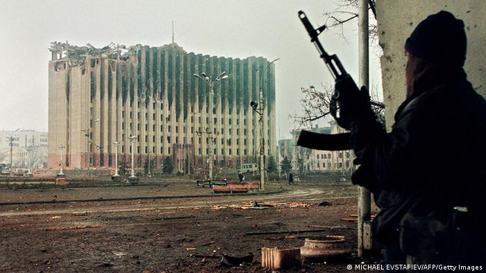 Picture taken on January 10, 1995 shows a Chechen fighter taking cover from sniper fire in a building across the square from the presidential palace destroyed by Russian artillery bombardments. Russia on April 16, 2009 ended an anti-terror operation in Chechnya that has been in place for a decade, amid growing stability in the territory torn by two wars since the collapse of Communism. AFP PHOTO / MICHAEL EVSTAFIEV (Photo credit should read MICHAEL EVSTAFIEV/AFP/Getty Images)
