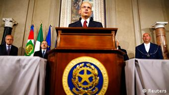 Italian Prime Minister-designate and deputy leader of the centre-left Democratic Party (PD) Enrico Letta speaks to reporters at the Quirinale Palace in Rome, April 27, 2013. Letta confirmed on Saturday that he could form a government that will include one of former prime minister Silvio Berlusconi closest allies as deputy prime minister. REUTERS/Alessandro Bianchi (ITALY - Tags: POLITICS ELECTIONS TPX IMAGES OF THE DAY) Italian Prime Minister-designate and deputy leader of the centre-left Democratic Party Letta speaks to reporters in Rome