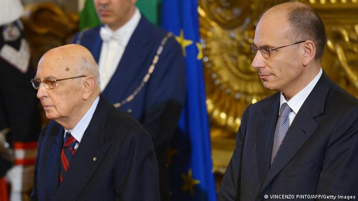Prime Minister Enrico Letta (L) shakes hands with President Giorgio Napolitano during his swearing in ceremony in Rome on April 28, 2013. Italy's new coalition government was sworn in on Sunday, bringing fresh hope to a country mired in recession after two months of bitter post-election deadlock watched closely by European partners. AFP PHOTO / VINCENZO PINTO (Photo credit should read VINCENZO PINTO/AFP/Getty Images)