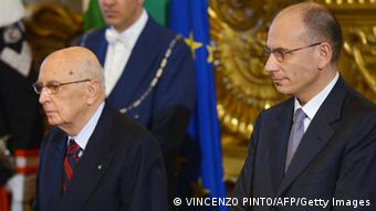 Prime Minister Enrico Letta (L) shakes hands with President Giorgio Napolitano during his swearing in ceremony in Rome on April 28, 2013. (Photo: VINCENZO PINTO/AFP/Getty Images)