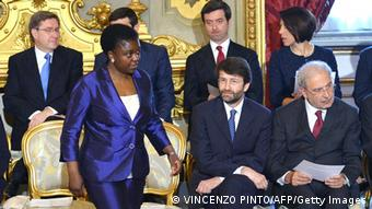 Italy's Integration minister Cecile Kyenge (L) stands during the swearing in ceremony in Rome of the new government of Prime Minister Enrico Letta on April 28, 2013. Italy's new coalition government was sworn in on Sunday, bringing fresh hope to a country mired in recession after two months of bitter post-election deadlock watched closely by European partners. AFP PHOTO / VINCENZO PINTO (Photo credit should read VINCENZO PINTO/AFP/Getty Images)