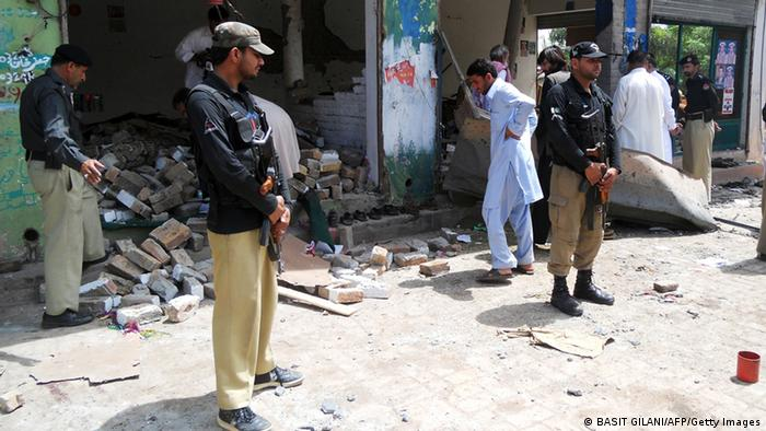 Pakistani police officials examine a destroyed office of an election candidate fallowing a bomb attack in the city of Kohat, adjacent to Pakistan's restive tribal areas along the Afghan border on April 28, 2013. Two bomb attacks targeting the offices of election candidates in northwest Pakistan killed at least eight people, officials said, the latest bloodshed ahead of polls next month. AFP PHOTO / BASIT GILANI (Photo credit should read BASIT GILANI/AFP/Getty Images)