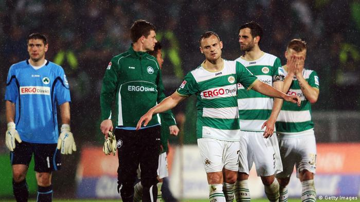 Bernd Nehrig (front) of Greuther Fuerth and team mates after the Bundesliga match between SpVgg Greuther Fuerth and Hannover 96 at Trolli-Arena on April 26, 2013 in Fuerth, Germany. (Photo by Alex Grimm/Bongarts/Getty Images)