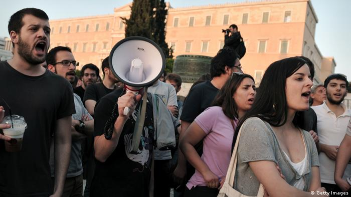 Protesters shout as they demonstrate in front of the parliament in Athens on April 28, 2013. Greek trade unions staged a protest ahead of a parliament vote on a bill that would spur unprecedented public sector job cuts to meet conditions set by Athens' creditors for billions in bailout loans. AFP PHOTO / LOUISA GOULIAMAKI (Photo credit should read LOUISA GOULIAMAKI/AFP/Getty Images)