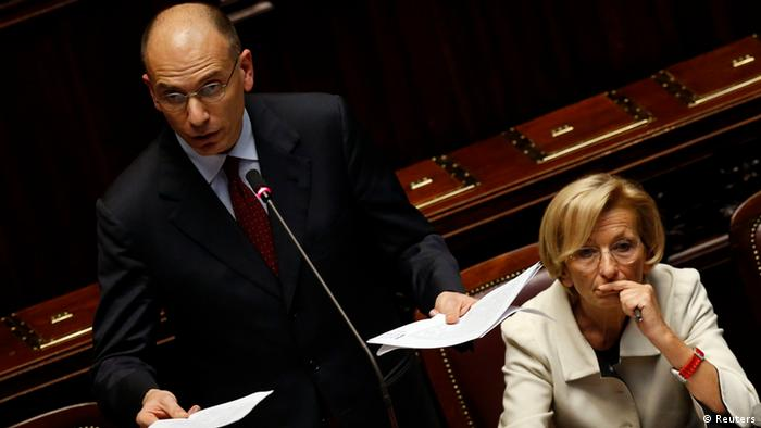 Newly appointed Italian Prime Minister Enrico Letta (L) speaks next to Foreign Minister Emma Bonino at the Lower house of the parliament in Rome, April 29, 2013. Letta said on Monday his government would stop the scheduled June installment of a hated property tax and would weigh a wider reform of the levy.REUTERS/ Alessandro Bianchi ( ITALY - Tags: POLITICS)