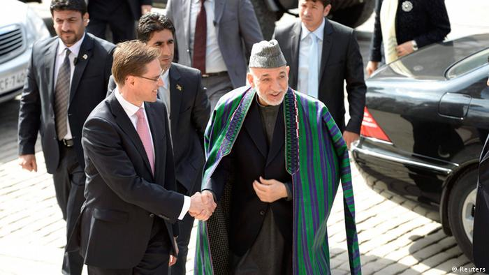 Afghan President Hamid Karzai and Finnish Prime Minister Jyrki Katainen shake hands as they arrive to the House of the Estates in Helsinki, Finland April 29, 2013. Karzai arrived in Finland for a working visit. REUTERS/Martti Kainulainen/Lehtikuva (FINLAND - Tags: POLITICS) THIS IMAGE HAS BEEN SUPPLIED BY A THIRD PARTY. IT IS DISTRIBUTED, EXACTLY AS RECEIVED BY REUTERS, AS A SERVICE TO CLIENTS. NO THIRD PARTY SALES. NOT FOR USE BY REUTERS THIRD PARTY DISTRIBUTORS. FINLAND OUT. NO COMMERCIAL OR EDITORIAL SALES IN FINLAND