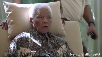 "In this image taken from video, the ailing anti-apartheid icon Nelson Madela is filmed Monday April 29, 2013, more than three weeks after being released from hospital. Mandela was treated in hospital for a recurring lung infection. South African President Jacob Zuma visited the former leader on Monday, but Mandela does not appear to speak during the televised portion of the visit, as he sits in an armchair, his head propped up by a pillow and with his cheeks showing what appear to be marks from a recently removed oxygen mask, although Zuma said he found Nelson Mandela ""in good shape and in good spirits"". (AP Photo/SABC TV) SOUTH AFRICA OUT"