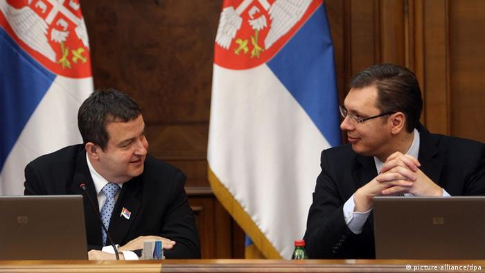 Serbian Prime Minister Ivica Dacic, (L) speaks with Serbian First Deputy Prime Minister and Defense Minister Aleksandar Vucic (R), during the government session in Belgrade, Serbia, 08 April 2013. Serbia has rejected a European Union-brokered deal for reconciliation with its former province of Kosovo and called for more negotiations with Kosovo Albanian leaders. The EU has given Serbia until Tuesday to say whether it would relinquish its effective control over northern Kosovo in exchange for the start of Serbia's EU membership negotiations. EPA/KOCA SULEJMANOVIC pixel