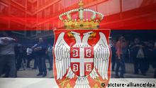 epa03673003 People are seen through a Serbian flag as they protest against an EU-sponsored deal between Serbia and breakaway Kosovo, in Belgrade, Serbia, 22 April 2013. Earlier in the day, the Serbian and Kosovan governments have reached a historic agreement aimed at turning the page on the Balkans' last simmering trouble-spot 14 years after the end of hostilities. The protesters demanded that the deal be annulled and called for the resignation of top Serbian officials. The 15-point EU-sponsored accord spells out the basic principles that would give a level of autonomy to some 40,000 ethnic Serbs living in the north Kosovo. The text of the accord has yet to be made public by the EU. EPA/KOCA SULEJMANOVIC +++(c) dpa - Bildfunk+++