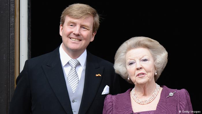 AMSTERDAM, NETHERLANDS - APRIL 30: Princess Beatrix of the Netherlands and King Willem Alexander appear on the balcony of the Royal Palace to greet the public after her abdication and ahead of the Inauguration of King Willem Alexander of The Netherlands on April 30, 2013 in Amsterdam, Netherlands. (Photo by Pascal Le Segretain/Getty Images)