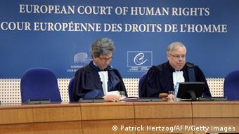 Dean Spielmann (R), Luxembourg's president of the European Court of Human Rights (ECHR) attends the audience during which the court ruled that the detention of Ukrainian opposition leader and former Prime Minister Yulia Tymoshenko was unlawful but threw out accusations of ill-treatment, on April 30, 2013, in Strasbourg, eastern France. The leader of the main opposition party in Ukraine Youlia Tymochenko was sentenced to seven years' imprisonment in October 2011, for what she alledges was a politically motivated prosecution. AFP PHOTO / PATRICK HERTZOG (Photo credit should read PATRICK HERTZOG/AFP/Getty Images)
