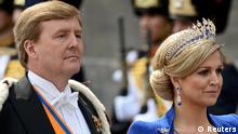 Dutch King Willem-Alexander (L) and his wife Queen Maxima arrive for a religious ceremony at Nieuwe Kerk church in Amsterdam April 30, 2013. The Netherlands is celebrating Queen's Day on Tuesday, which will also mark the abdication of Queen Beatrix and the investiture of her eldest son Willem-Alexander. REUTERS/Dylan Martinez (NETHERLANDS - Tags: POLITICS ENTERTAINMENT ROYALS)