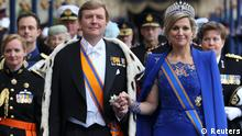 Dutch King Willem-Alexander and his wife Queen Maxima walk after attending a religious ceremony at the Nieuwe Kerk church in Amsterdam April 30, 2013. The Netherlands is celebrating Queen's Day on Tuesday, which also marks the abdication of Queen Beatrix and the investiture of her eldest son Willem-Alexander. REUTERS/Jasper Juinen/Pool (NETHERLANDS - Tags: ROYALS POLITICS ENTERTAINMENT)