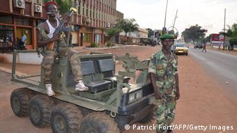 Seleka rebels pose in a vehicle left by South-African soldiers , on April 4, 2013 in a street of Bangui. South African President Jacob Zuma, facing a firestorm over the deaths of 13 soldiers in a coup in the Central African Republic, said on April 4, 2013 he was withdrawing troops from the restive nation.AFP PHOTO / PATRICK FORT (Photo credit should read PATRICK FORT/AFP/Getty Images)