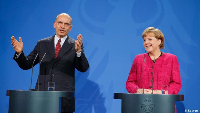 German Chancellor Angela Merkel and Italian Prime Minister Enrico Letta address news conference at the Chancellery in Berlin, April 30, 2013. REUTERS/Fabrizio Bensch (GERMANY - Tags: POLITICS)