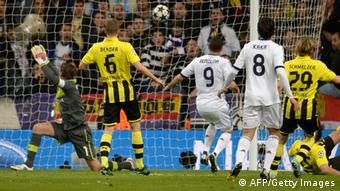 Real Madrid's French forward Karim Benzema (3rd L) scores during the UEFA Champions League semi-final second leg football match Real Madrid CF vs Borussia Dortmund at the Santiago Bernabeu stadium in Madrid on April 30, 2013. AFP PHOTO / DANI POZO (Photo credit should read DANI POZO/AFP/Getty Images)